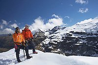 Two mountain climbers on snowy peak