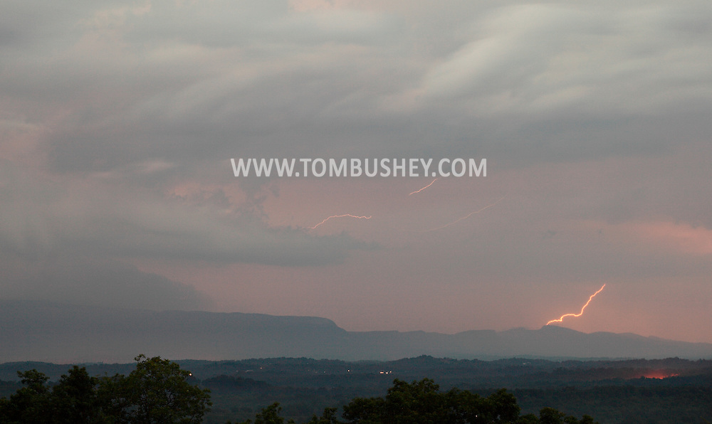 Scotchtown, NY - Lightning strikes in the distance over the Shawangunk Ridge on the evening July 7, 2009.