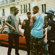 Group of teenagers standing on the street in Paris