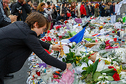 © Licensed to London News Pictures. 17/11/2015. Paris, France. Mourners visit a memorial at Place de la Republique in Paris, France following the Paris terror attacks on Tuesday, 17 November 2015. Photo credit: Tolga Akmen/LNP
