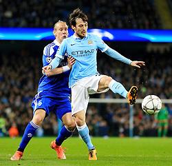 David Silva of Manchester City is closed down by Domagoj Vida of Dynamo Kyiv  - Mandatory byline: Matt McNulty/JMP - 15/03/2016 - FOOTBALL - Etihad Stadium - Manchester, England - Manchester City v Dynamo Kyiv - Champions League - Round of 16