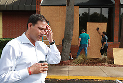 Owner C.B. Yadav stands outside his Cumberland Inn & Suites hotel as employees board up the windows in preparation for Hurricane Dorian on Monday, September 2, 2019, in St. Mary's. Mandatory evacuation has been issued for the area east of Interstate 95 but the hotel is staying open for employees and emergency workers. Photo by Curtis Compton/Atlanta Journal-Constitution/TNS/ABACAPRESS.COM  | 697831_009 St. Mary's Etats-Unis United States