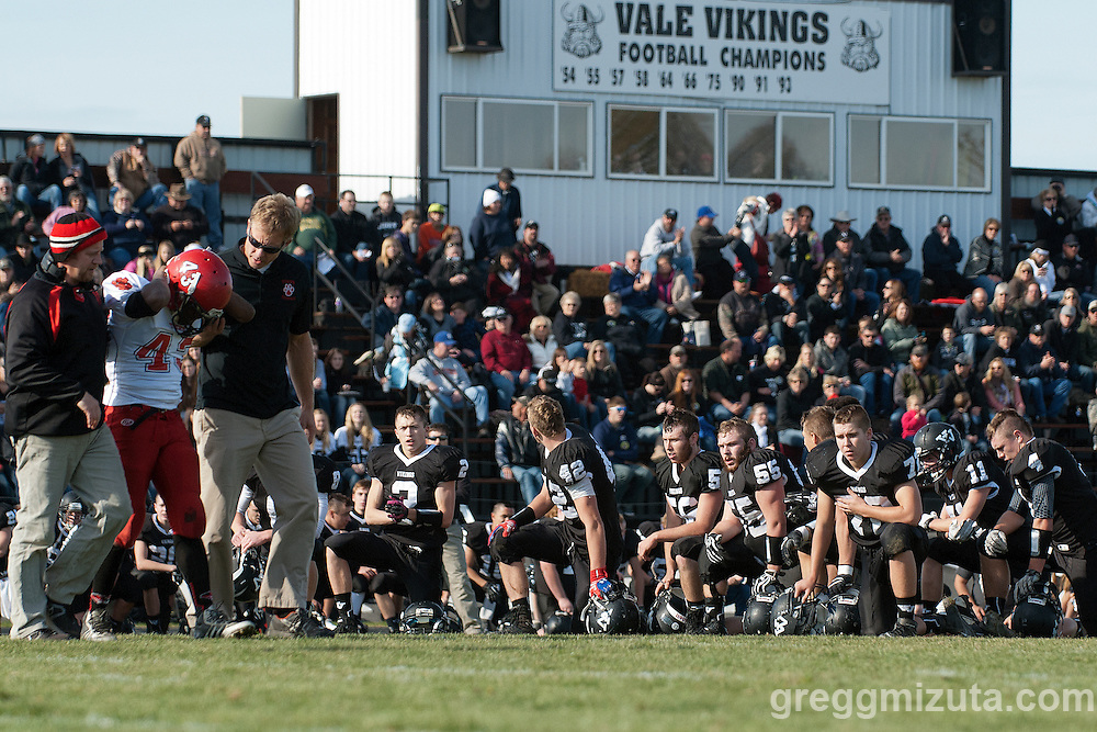 Cedet Bailey leaves the field as the Vale (L to R: Josh Schoorl, Agi Tamez, Sage Delong, Keaton Kimball, Tyson Aldred, Michael Young, Colton Friend, Andrew Weber) looks on. Bailey returned to play the remainder of the game. Vale Clatskanie round 1 playoff game, November 9, 2013 at Frank Hawley Stadium Vale High School, Vale, Oregon. Vale won 46-0.