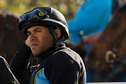 Freelance exercise rider Zeke Castro waits near the track during workouts, Tuesday, April 30, 2013 at Churchill Downs in Louisville. Photo by Jonathan Palmer
