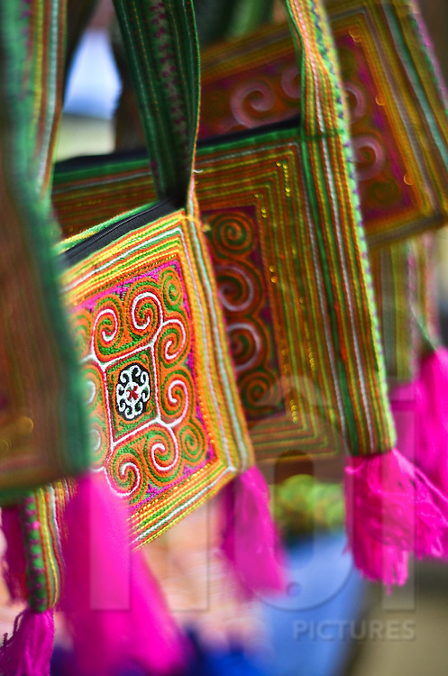 Traditional colorful small bags made by ethnic minorities and sold at a village market in Lao Cao province, Bac Ha district, North Vietnam, Southeast Asia