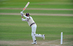 Somerset's Craig Overton sweeps the ball. - Photo mandatory by-line: Harry Trump/JMP - Mobile: 07966 386802 - 07/07/15 - SPORT - CRICKET - LVCC - County Championship Division One - Somerset v Sussex- Day Three - The County Ground, Taunton, England.
