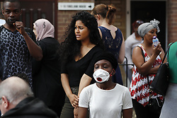 © Licensed to London News Pictures. 14/06/2017. London, UK. People wait at casualty centre as the Grenfell Tower fire still is not under control 14 hours after the fire broke in west London on 14 June 2017. Photo credit: Tolga Akmen/LNP