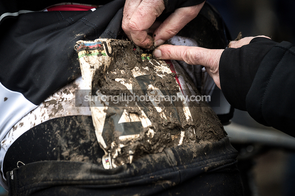 UCI Cyclo-cross World Championships in Valkenburg 2018. Marcel Wildhaber has his number removed after the race. Photo by Simon Gill.