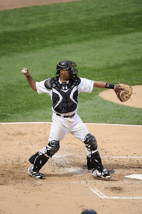 CHICAGO - JUNE 25:  Ramon Castro #27 of the Chicago White Sox throws the ball while catching against the Washington Nationals on June 25, 2011 at U.S. Cellular Field in Chicago, Illinois.  The White Sox defeated the Nationals 3-0.  (Photo by Ron Vesely)   Subject:  Ramon Castro