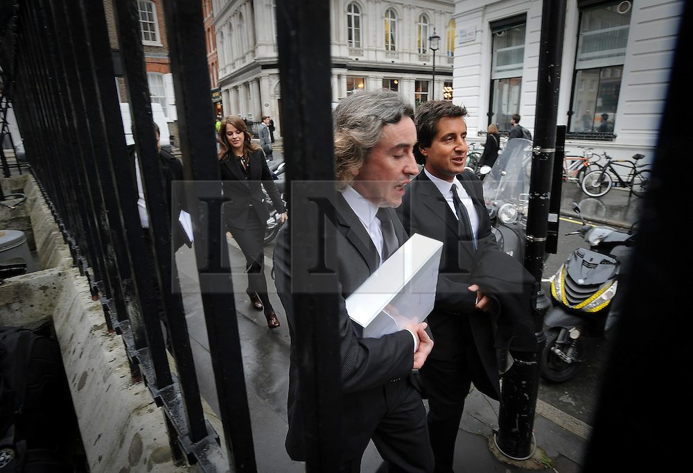 © London News Pictures. 22/11/2011. London, UK.  Comedian STEVE COOGAN (left) and DAVID SHERBORNE  QC (right)  arriving at The Royal Courts of Justice today (22/11/2011) to give evidence at the Leveson Inquiry into press standards. The inquiry is being lead by Lord Justice Leveson and is looking into the culture, and practice of the UK press. The Leveson inquiry, which may take a year or more to complete, comes after The News of The World Newspaper was closed following a phone hacking scandal. Photo credit : Ben Cawthra/LNP