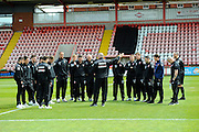 Morecambe manager Jim Bentley talking to his players before the Sky Bet League 2 match between Exeter City and Morecambe at St James' Park, Exeter, England on 30 April 2016. Photo by Graham Hunt.