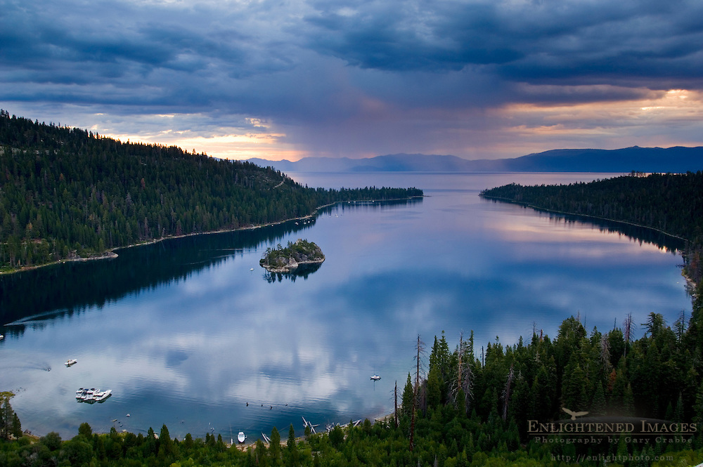 Rain storm clouds at sunrise over the still waters of Emerald Bay State Park, South Lake Tahoe region, California