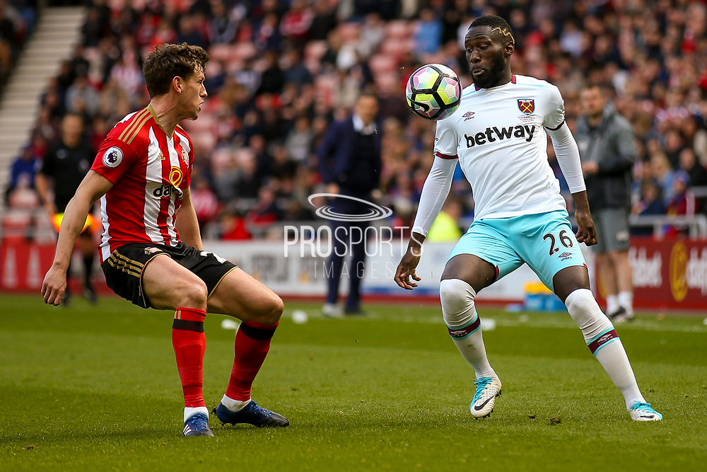 Sunderland defender Billy Jones (2) closes down West Ham United Defender Arthur Masuaku (26)  during the Premier League match between Sunderland and West Ham United at the Stadium Of Light, Sunderland, England on 15 April 2017. Photo by Simon Davies.