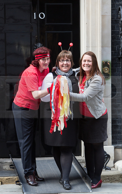 © Licensed to London News Pictures. 17/03/2014. London, UK. Guests pose outside Downing Street for a Sport Relief reception hosted by the Prime Minister, David Cameron on 17th March 2014. Photo credit : Vickie Flores/LNP