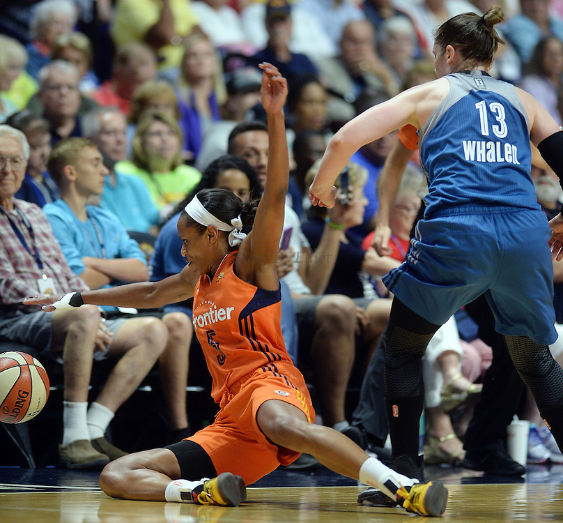 7/7/16 :: SPORTS :: GRIFFEN :: Connecticut's Jasmine Thomas goes sliding out of bounds after the ball after poking it away from Minnesota's Lindsay Whalen in WNBA action Thursday, July 7, 2016 at Mohegan Sun Arena. The Sun came back to take a 93-89 overtime win over the defending WNBA champion Lynx. (Sean D. Elliot/The Day)