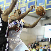 Delaware 87ers Guard Lorenzo Brown (17) drives towards the basket as a Austin Toros defender defends in the course of a NBA D-league regular season basketball game between the Delaware 87ers (76ers) and the Austin Toros (Spurs) Monday, Jan. 27, 2014 at The Bob Carpenter Sports Convocation Center, Newark, DE