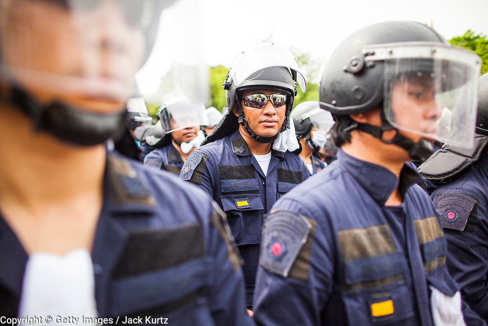 24 NOVEMBER 2012 - BANGKOK, THAILAND: Thai riot police deploy during a large anti government, pro-monarchy, protest  on November 24, 2012 in Bangkok, Thailand. The Siam Pitak group, which sponsored the protest, cited alleged government corruption and anti-monarchist elements within the ruling party as grounds for the protest. Police used tear gas and baton charges againt protesters.       PHOTO BY JACK KURTZ