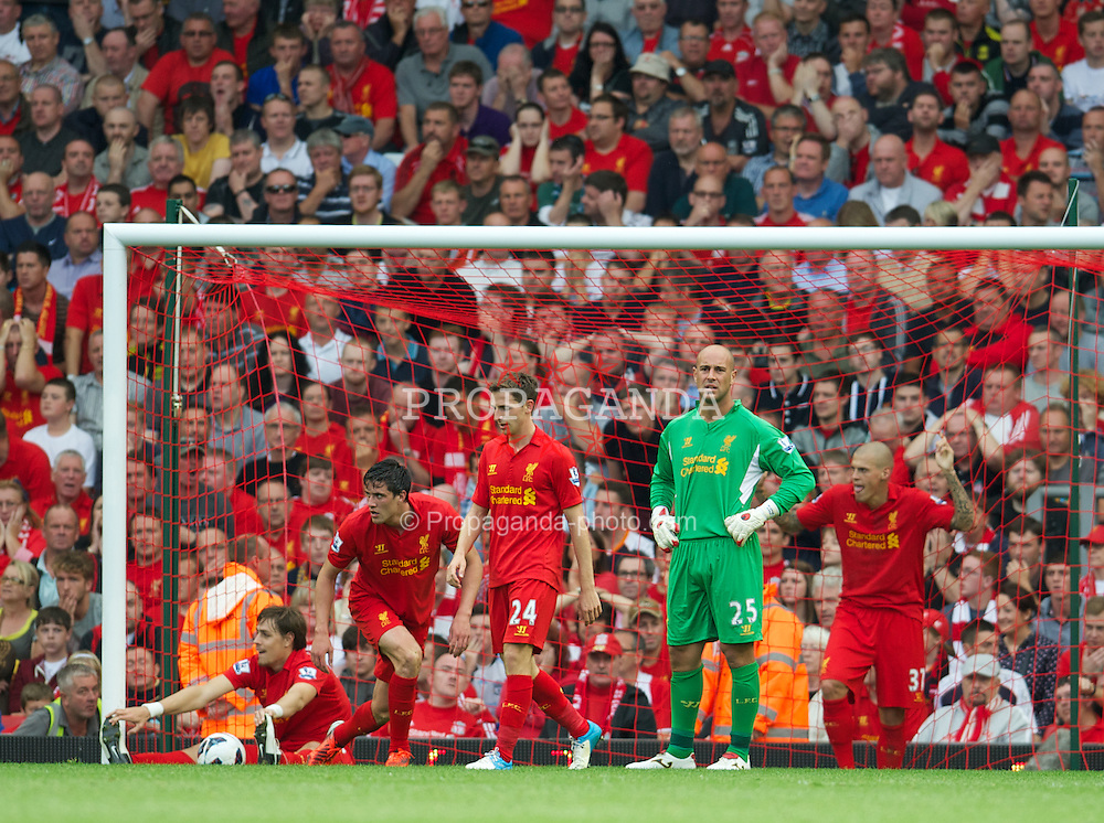 LIVERPOOL, ENGLAND - Sunday, August 26, 2012: Liverpool's Sebastian Coates, Martin Kelly, Joe Allen, goalkeeper Jose Reina and Martin Skrtel look dejected as Manchester City score the first equalising goal during the Premiership match at Anfield. (Pic by David Rawcliffe/Propaganda)
