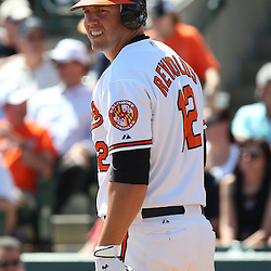 March 14, 2011; Sarasota, FL, USA; Baltimore Orioles third baseman Mark Reynolds (12) during a spring training exhibition game against the Pittsburgh Pirates at Ed Smith Stadium.   Mandatory Credit: Derick E. Hingle