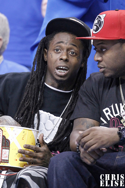 12 June 2012: American rapper Lil Wayne is seen courtside during the Oklahoma City Thunder 105-94 victory over the Miami Heat, in Game 1 of the 2012 NBA Finals, at the Chesapeake Energy Arena, Oklahoma City, Oklahoma, USA.