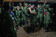 Guerrilleros de las FARC reunidos para celebrar el cumpleaños del comandante del frente 34 Pedro Baracutao. <br /> Photo Federico Rios / Native