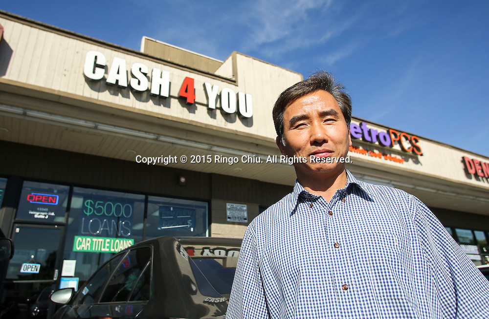 Michael Kyong Kim, owner of payday lender Cash 4 You Plus in Santa Fe Spring.<br /> (Photo by Ringo Chiu/PHOTOFORMULA.com)<br /> <br /> Usage Notes: This content is intended for editorial use only. For other uses, additional clearances may be required.