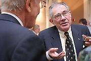 16399Fred Harris Art opening at the Kennedy Museum of Art: Photos Celeste Elliott..Frederick Harris talks with former President Ping at the opening of his art exhibition in the Kennedy Musuem Thursday, April 15, 2004. The exhibition is focused around Harris' work in Vietnam.