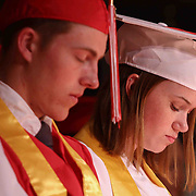 Red Lion Christian Academy students pray during commencement exercise Friday, May 29, 2015, at Glasgow Church in Bear, Delaware.