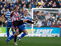 Photo: Gareth Davies.<br />Reading v Sheffield United. The Barclays Premiership. 20/01/2007.<br />Sheffield United's Rob Hulse (L) clears the ball away from Reading's Steve Sidwell (R)