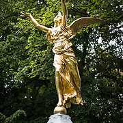 A gold statue of an angel in the Square de Meeûs in the EU district of Brussels, not far from the European Parliament complex.