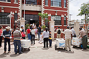 Apr. 27, 2009 -- NOGALES, SONORA, MEXICO: Ice cream vendors wait for school children in Nogales, Sonora, Mexico, as school closes until at least May 6 because of the outbreak of swine flu. The Mexican government broadened its efforts to control the outbreak of swine flu Monday closing schools throughout the country. In Nogales, on Mexico's northern border with the US, people started wearing masks as news of the outbreak spread.  Photo by Jack Kurtz