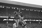 Three players collide mid air as they go for the ball during the All Ireland Senior Gaelic Football Final, Kerry v Dublin in Croke Park on the 28th September 1975. Kerry 2-12 Dublin 0-11.