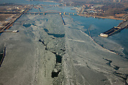 Nederland, Noord-Holland, Amsterdam, 10-01-2009; IJsgang op het Buiten-IJ, ijsschotsen en ijsvelden, rechts de ingang Zeeburgertunnel; op het tweede plan de Schellingwouderbrug met daar achter de Oranjesluizen en het IJ; ice-floe and ice-fields around the entrance ofnthe Zeeburgertunnel, northern part Amsterdam; on the second plan with Schellingwouderbrug behind the Orange Sluices and IJ;.ijsschots, ijsveld, veld, schots, schotsen, ijsgang, ijs, natuurijs, winter, koud, vriezen, min nul, beneden nul, koud, celsius, ice, snow, cold, freezing, minus zero, below zero, cold, winterlandschap, winter landscape. .luchtfoto (toeslag); aerial photo (additional fee required); .foto Siebe Swart / photo Siebe Swart