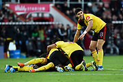 Goal - Roberto Pereyra (37) of Watford is mobbed as he celebrates after scoring a goal to give a 0-3 lead during the Premier League match between Bournemouth and Watford at the Vitality Stadium, Bournemouth, England on 12 January 2020.