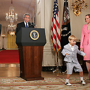 Jack Roberts dances as President Bush announces his Supreme Court nominee (SCOTUS) John Roberts in the State Dining room of the White House Tuesday, July 19, 2005.  Also attending are Roberts's wife Jane Sullivan Roberts and daughter Josie Roberts...Photo by Khue Bui