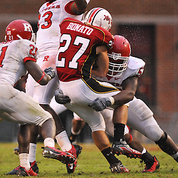 Sep 26, 2009; College Park, MD, USA; Rutgers defensive end Eric Legrand (52) tackles Maryland running back Dan Bonato (27) during Rutgers' 34-13 victory over Maryland in NCAA college football at Byrd Stadium.