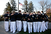 Virginia Tech military cadets hold their arms around each other in a prayer circle after lowering the flag to half mast in honor of students that were killed during a shooting rampage one day ago, at Virginia Tech University in Blacksburg, Virginia 17 April 2007. Virginia Tech officials said Tuesday that a student was the gunman in at least the second of the two campus attacks that claimed 33 lives, in the deadliest shooting in modern U.S. history.