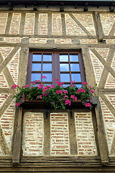 Window box brimming with geraniums in Amboise, Loire Valley, France.
