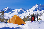 Yellow dome tent and backcountry ski camp in Little Lakes Valley, Inyo National Forest, Sierra Nevada Mountains, California