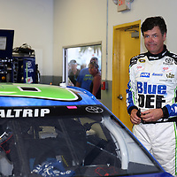 Racecar driver Michael Waltrip is seen in his garage area during the  56th Annual NASCAR Daytona 500 practice session at Daytona International Speedway on Wednesday, February 19, 2014 in Daytona Beach, Florida.  (AP Photo/Alex Menendez)