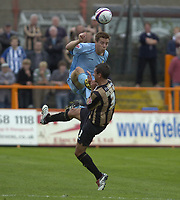 Photo: Matt Bright.<br /> Barnet v Mansfield Town. Coca Cola League 2. 13/10/2007.<br /> Johnny Mullins of Mansfield Town makes a stong arial challeng on  Joe Devera of Barnet