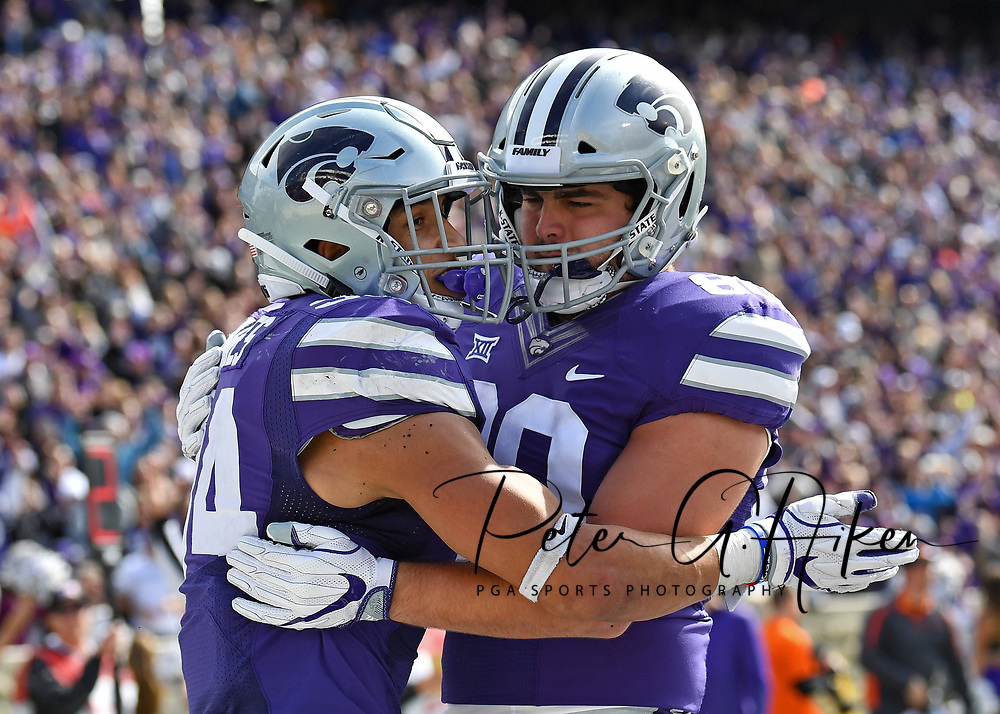 MANHATTAN, KS - OCTOBER 13:  Running back Alex Barnes #34 of the Kansas State Wildcats celebrates with tight end Blaise Gammon #89 of the Kansas State Wildcats after scoring a touchdown against the Oklahoma State Cowboys during the second half on October13, 2018 at Bill Snyder Family Stadium in Manhattan, Kansas.  (Photo by Peter G. Aiken/Getty Images) *** Local Caption *** Alex Barnes; Blaise Gammon