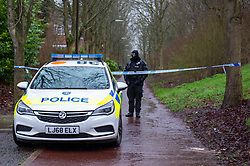 © Licensed to London News Pictures. 12/12/2019. Milton Keynes, UK. A Police officer maintains a cordon across a walkway in the Fishermead area after a man was stabbed. Thames Valley Police has launched a murder investigation following the death of a man in Milton Keynes. Police and South Central Ambulance Service attended a woodland in Fishermead, Milton Keynes at around 15:20GMT on Wednesday 11th December 2019 after a report of an altercation between a group of men, during which a man had been stabbed. The victim, a man aged in his twenties died at the scene. Photo credit: Peter Manning/LNP