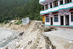 2nd, July 2013, Karadhi, Uttarkashi. On the 16th and 17th June the South West monsoon came earlier than expected with particularly heavy rain fall in the North Indian Himalayan state of Uttarakhand, causing wide spread flooding. Here a road has been completely washed away; an essential life line for the villagers.  MANDATORY CREDIT: © Sam Spickett/RedR India, under license to London News Pictures.