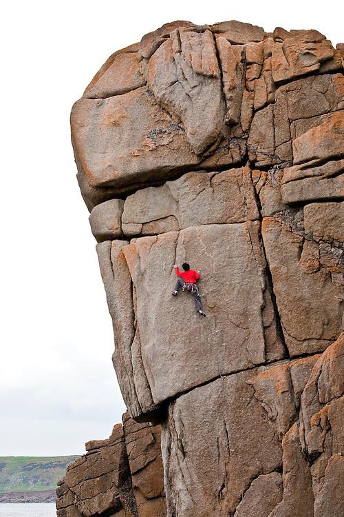 Toru Nakajima climbing 'Demolition' E6 6a at Sennen, Cornwall, England