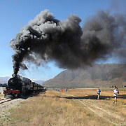 Almost 500 runners run alongside the Kingston Flyer Vintage Steam train during the 12km 'Race the Train' event run from Fairlight Station to Kingston Station, Kingston, Otago, New Zealand. 8th January 2012
