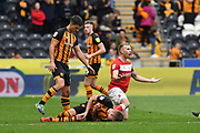 Bristol City player Andreas Weimann (14) crashes into Hull City midfielder Markus Henriksen (22) during the EFL Sky Bet Championship match between Hull City and Bristol City at the KCOM Stadium, Kingston upon Hull, England on 5 May 2019.
