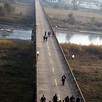 TUMEN, OCTOBER-26:  Chinese tourists return from the  demarcation line between North Korea and China ,October 26,2006.