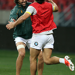 PORT ELIZABETH, SOUTH AFRICA - JUNE 27: Victor Matfield (captain) of South Africa  blocks Jan Serfontein of South Africa during the South African National rugby team captains run and official team photograph at Nelson Mandela Bay Stadium on June 27, 2014 in Port Elizabeth, South Africa. (Photo by Steve Haag/Gallo Images)