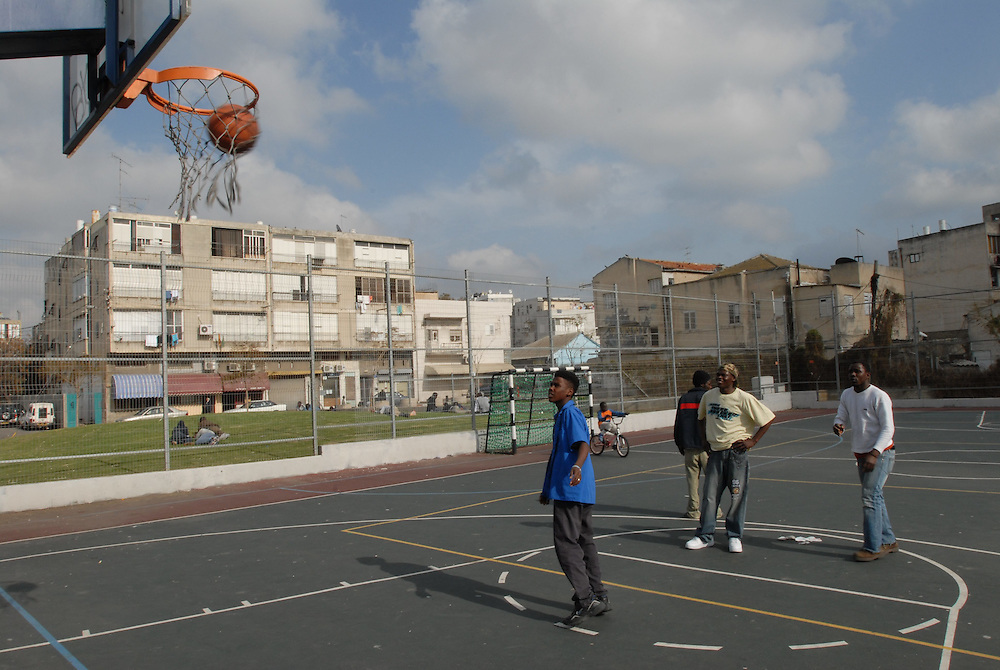 Foreign workers are playing basketball in Neve Shaanan, Tel-Aviv. Neve Sha'anan is one of Tel Aviv's oldest neighborhoods. It is also a major transportation hub, containing both the new and old Tel Aviv Central Bus Stations. Neve Sha'anan is also Tel Aviv's red-light district, with numerous brothels. As such, many foreign workers live or look for work in Neve Sha'anan. Feb 29, 2008. Photo by Gili Yaari  *** Local Caption *** ???? ????, ???? ?????? ?????, ???????, ?????? ????, ?????, ???????,..??????, ????